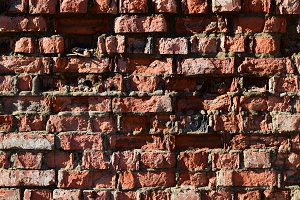 Destroyed by time and precipitation brick wall.