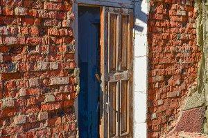 Broken doors in abandoned building