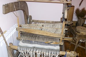 Ancient wooden loom. Ancient textile equipment.