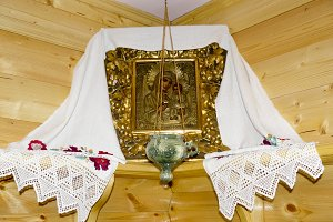 The Orthodox icon of the Mother of God and Jesus with the lamp in the corner of the room