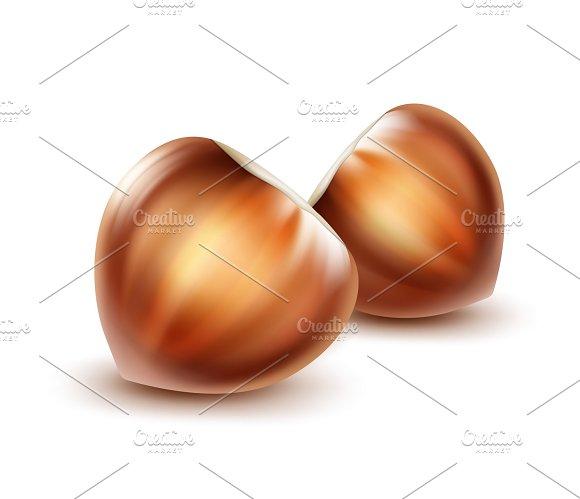 Two whole unpeeled hazelnuts
