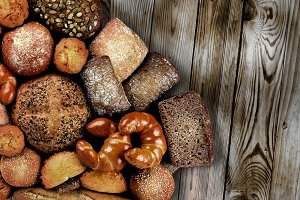 bread products on dark plank