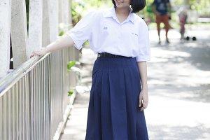 Asian schoolgirl smiling.