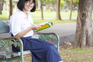 Girl sitting and reading a book.