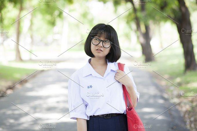 Schoolgirl. Red carrying bag - People