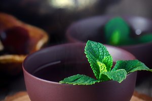 Bowl with tea and fresh mint.