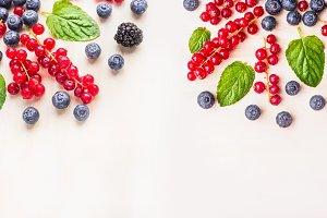 Fresh organic berries on white
