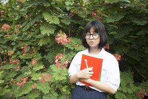 Schoolgirl with wear glasses looks
