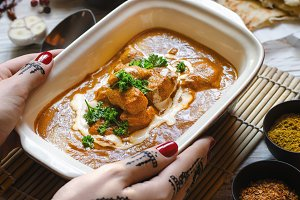 Butter chicken curry with naan.