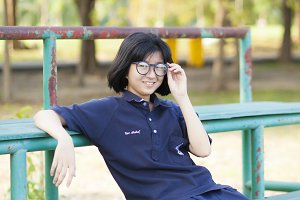 Girl wearing glasses sitting