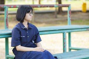 Girl wearing glasses sitting