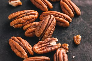 Macro photography of pecan nuts.