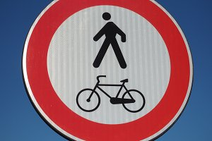 no pedestrians and bikes traffic sign over blue sky