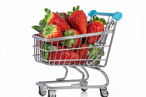 Tasty strawberry in shopping cart.