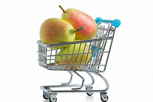 Mature pears in supermarket trolley.