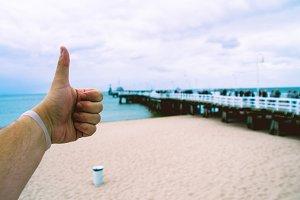 Man thumbs up the beach