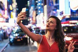 Beautiful woman using phone.