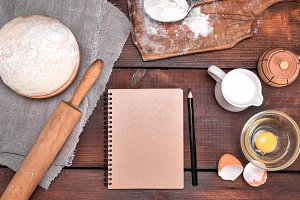open blank notebook and ingredients
