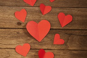 Red heart paper on wooden background
