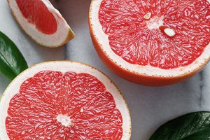 Close-up of grapefruits on white