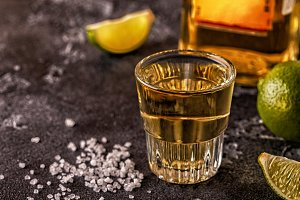Tequila in shot glasses with lime an