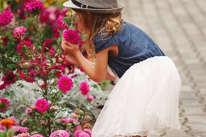 little beautiful girl in flowers park