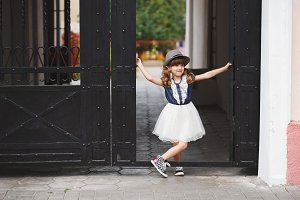 little funny girl posing outdoors