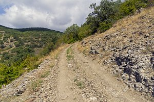 A dirt road on steep mountain slope