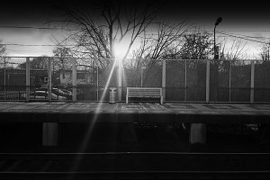 Horizontal black and white railroad city bench background