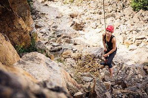 Young Climber Holding Rope For Team Mate