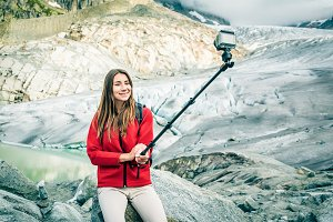 Young Woman Hiking In The Swiss Alps, Taking A Selfie