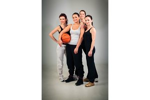 4 Women Playing Basketball
