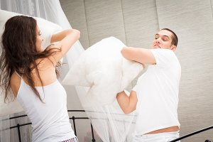 Couple Having A Pillow Fight