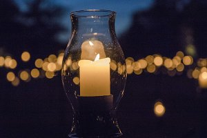 Glass candle at night