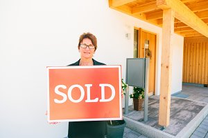 Female Realtor in Front of a House