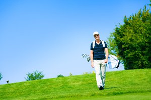 Man Walking To His Golf Ball