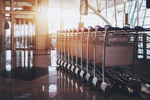 Luggage carts in airport terminal