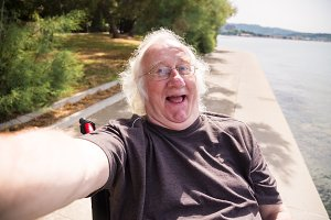 Old Man In Wheelchair Taking A Selfie