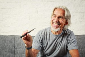 Senior Vaping, Enjoying An Electronic Cigarette