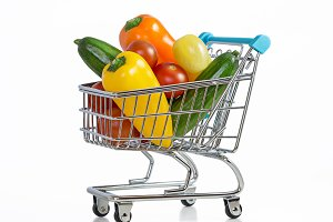 Fresh vegetables in trolley isolated
