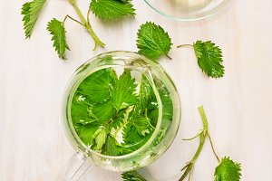 Nettle tea with glass pot and cup