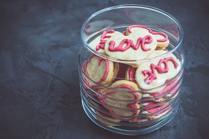 Fragrant cookies in the shape of a heart with the word love
