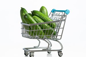 Supermarket trolley with cucumbers.