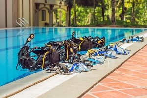 Equipment for diving is on the edge of the pool, ready for a lesson