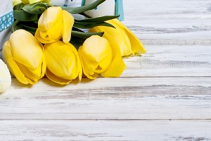 bouquet of yellow tulips and chikken