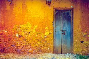 Cracked wall with door. Vintage background.