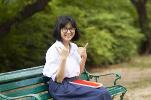 Schoolgirl. Sitting on the bench