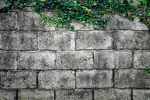 Grey stone wall made of bricks. Background.