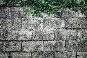 Grey stone wall made of bricks. Background.