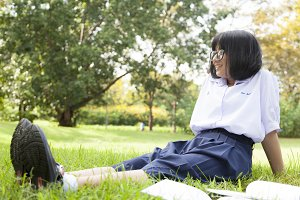 Schoolgirl is sitting and relaxing.